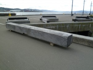 Open waterfront area with hardwood bench seat and sea in background