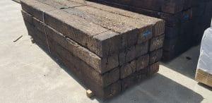 A bundle of railway sleepers stacked